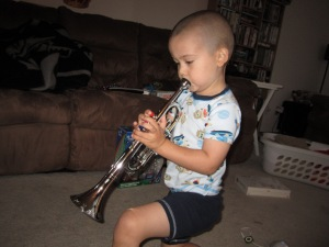 Blowing on his new trumpet